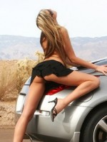 Carmen strips down on her car